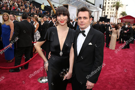 Karen O, left, and Barnaby Clay arrive at the Oscars, at the Dolby Theatre in Los Angeles