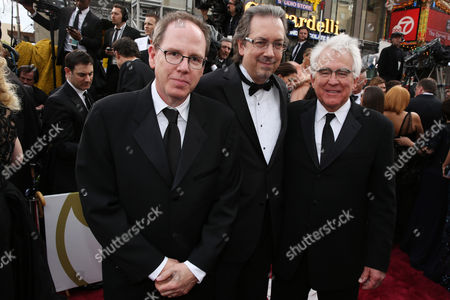From left, Albert Berger, Bob Nelson and Ron Yerxa arrive at the Oscars, at the Dolby Theatre in Los Angeles