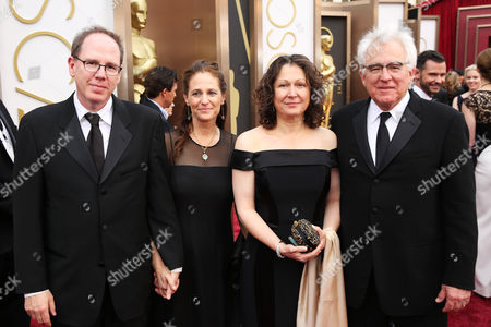 Albert Berger, from left, Ellen Steloff, Annette Yerxa and Ron Yerxa arrive at the Oscars, at the Dolby Theatre in Los Angeles