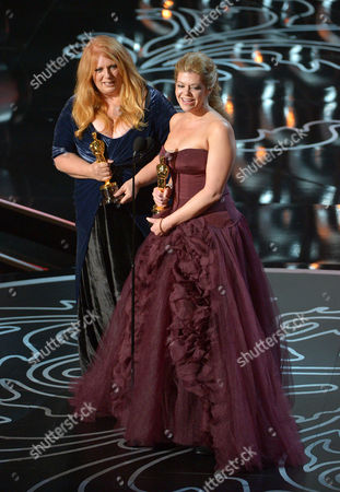 "Adruitha Lee, left, and Robin Mathews accept the award for best makeup and hairstyling for ""Dallas Buyers Club"" during the Oscars at the Dolby Theatre, in Los Angeles"