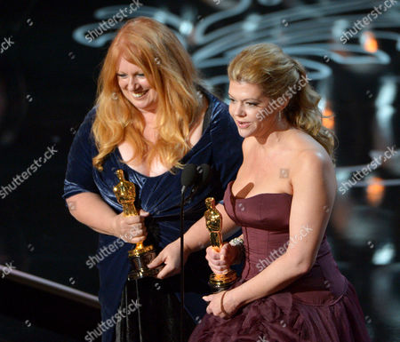 "Adruitha Lee, left, and Robin Mathews accept the award for best makeup and hairstyling for ""Dallas Buyers Club"" on stage during the Oscars at the Dolby Theatre, in Los Angeles"