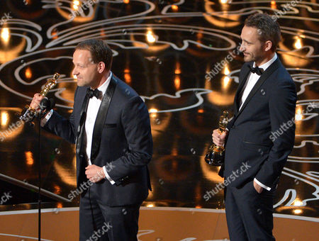 Kim Magnusson, left, and Anders Walter accept the award for best live action short film of the year for 'Helium' on stage during the Oscars at the Dolby Theatre, in Los Angeles