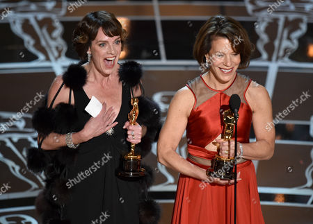 Dana Perry, left, and Ellen Goosenberg Kent accept the award for best short subject documentary for Crisis Hotline: Veterans Press 1 at the Oscars, at the Dolby Theatre in Los Angeles