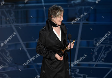 Milena Canonero accepts the award for best costume design for The Grand Budapest Hotel at the Oscars, at the Dolby Theatre in Los Angeles