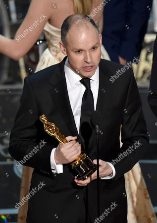 Paul Franklin accepts the award for best visual effects for Interstellar at the Oscars, at the Dolby Theatre in Los Angeles