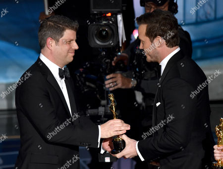 Chris Pratt, right, presents Adam Stockhausen with the award for best production design for The Grand Budapest Hotel at the Oscars, at the Dolby Theatre in Los Angeles