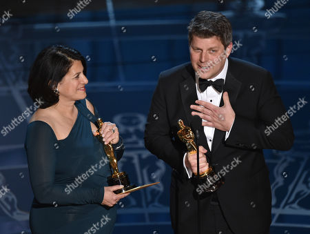 Anna Pinnock, left, and Adam Stockhausen accept the award for best production design for â?oeThe Grand Budapest Hotelâ?? at the Oscars, at the Dolby Theatre in Los Angeles