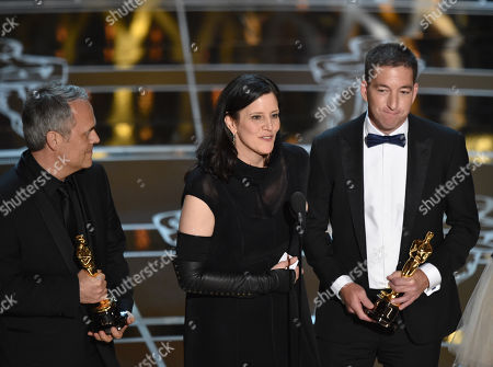 Dirk Wilutzky, from left, Laura Poitras and Glenn Greenwald accept the award for best documentary feature for â?oeCitizenfourâ?? at the Oscars, at the Dolby Theatre in Los Angeles