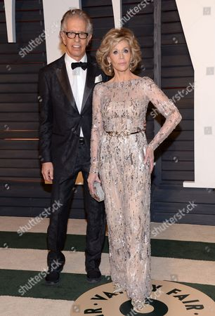 Richard Perry, left, and Jane Fonda arrive at the 2015 Vanity Fair Oscar Party, in Beverly Hills, Calif