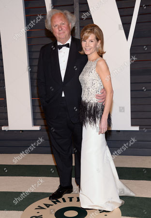 Graydon Carter, editor-in-chief, U.S. Vanity Fair, left, and Anna Scott arrive at the 2015 Vanity Fair Oscar Party, in Beverly Hills, Calif