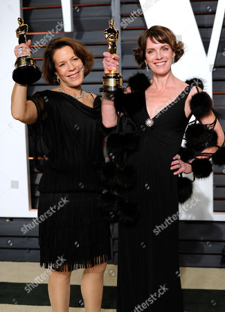 """Ellen Goosenberg Kent, left, and Dana Perry, the winners of the award for documentary short subject for """"Crisis Hotline: Veterans Press 1,"""" arrive at the 2015 Vanity Fair Oscar Party, in Beverly Hills, Calif"""