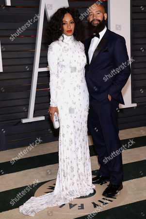 Solange Knowles, left, and Alan Ferguson arrive at the 2015 Vanity Fair Oscar Party, in Beverly Hills, Calif