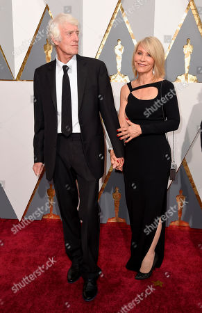 Roger Deakins, left, and Isabella James Purefoy Ellis arrive at the Oscars, at the Dolby Theatre in Los Angeles
