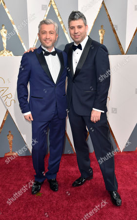 Den Tolmor, left, and Evgeny Afineevsky arrive at the Oscars, at the Dolby Theatre in Los Angeles