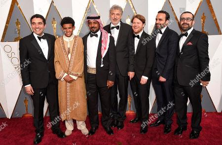 Naji Abu Nowar, from left, Jacir Eid, Hassan Mutlag Al-Maraiyeh, Wolfgang Thaler, Rupert Lloyd, Bassel Ghandour and Laith Majali arrive at the Oscars, at the Dolby Theatre in Los Angeles