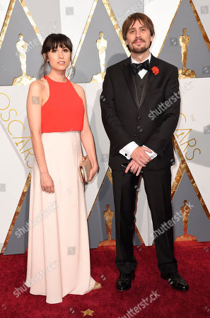 Stock Picture of Julia Pott, left, and Don Hertzfeldt arrive at the Oscars, at the Dolby Theatre in Los Angeles