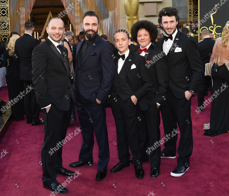 Jamie Donoughue, from left, Eshref Durmishi, Andi Bajgora, Lum Veseli, and Harvey Ascott arrive at the Oscars, at the Dolby Theatre in Los Angeles