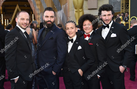 Stock Image of Jamie Donoughue, from left, Eshref Durmishi, Andi Bajgora, Lum Veseli, and Harvey Ascott arrive at the Oscars, at the Dolby Theatre in Los Angeles