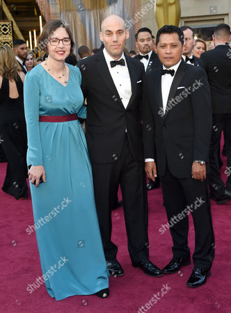Signe Byrge Sorensen, from left, Joshua Oppenheimer, and Adi Rukun arrive at the Oscars, at the Dolby Theatre in Los Angeles