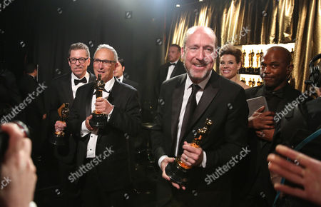 Gregg Rudloff, from left, Ben Osmo, and Chris Jenkins, winners of the award for best sound mixing for Mad Max: Fury Road, appear backstage at the Oscars, at the Dolby Theatre in Los Angeles