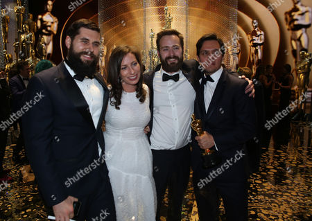 Benjamin Cleary, from left, Serena Armitage, Michael Paleodimos, and Shan Christopher Ogilvie, winners of the award for best live action short film for Stutterer appear backstage at the Oscars, at the Dolby Theatre in Los Angeles