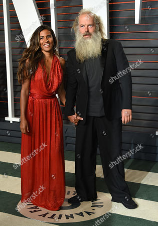 Mourielle Herrera, left, and Rick Rubin arrive at the Vanity Fair Oscar Party, in Beverly Hills, Calif