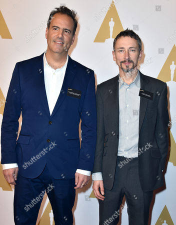 Christopher Scarabosio, left, and Stuart Wilson arrive at the 88th Academy Awards Nominees Luncheon at The Beverly Hilton hotel, in Beverly Hills, Calif