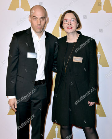 Joshua Oppenheimer, left, and Signe Byrge Sorensen arrive at the 88th Academy Awards Nominees Luncheon at The Beverly Hilton hotel, in Beverly Hills, Calif