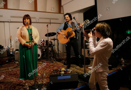 Wendy Wilson and Carnie Wilson perform as Glen Ballard takes a photo at A Night for Jolie Levine Sponsored by Lupus LA & Sweet Relief Musicians Fund, at Henson Studios on Friday, May, 31, 2013 in Los Angeles