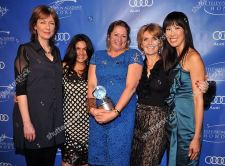 """MAY 2: (L-R) Executive producers Pamela Hogan, senior producer Nina Chaudry, executive producers Gini Reticker, Abigail Disney and Laura Ling with the Academy honor award for """"Women, War & Peace"""" attends the Academy of Television Arts & Sciences Presents """"The 5th Annual Television Academy Honors"""" at the Beverly Hills Hotel on in Beverly Hills, California"""