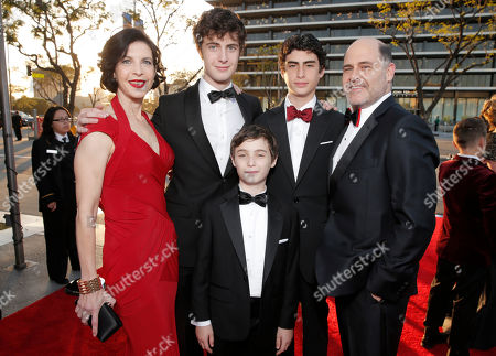 """Linda Brettler, left, and Matthew Weiner, right, with family arrive at AMC's Black & Red Ball to celebrate the final episodes of """"Mad Men"""" at Dorothy Chandler Pavilion, in Los Angeles"""