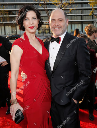 Matthew Weiner, right, and Linda Brettler arrive at AMC's Black & Red Ball to celebrate the final episodes of 'Mad Men' at Dorothy Chandler Pavilion, in Los Angeles