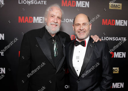 """Robert Towne, left, and Matthew Weiner arrive at AMC's Black & Red Ball to celebrate the final episodes of """"Mad Men"""" at Dorothy Chandler Pavilion, in Los Angeles"""