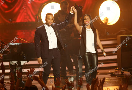 John Legend, left, and Malaya Watson perform on stage at the American Idol XIII finale at the Nokia Theatre at L.A. Live, in Los Angeles
