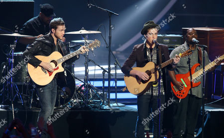 Phillip Phillips, left, and Sam Woolf perform on stage at the American Idol XIII finale at the Nokia Theatre at L.A. Live, in Los Angeles
