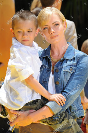 """Jaime Pressly, at right, and her son, Dezi James Calvo arrives at the American premiere of """"Despicable Me 2"""" at the Universal City Walk on in Universal City, Calif"""