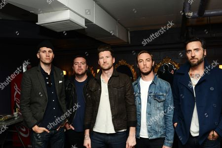 Nathan Young, Joseph Milligan, Stephen Christian, Deon Rexroat, and Christian McAlhaney of Anberlin posed backstage, at Center Stage Theater, in Atlanta