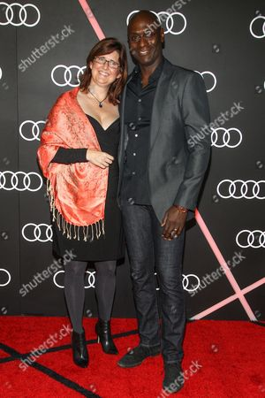 Lance Reddick (R) and Stephanie Reddick arrive to the Audi Golden Globes Cocktail Party held at Cecconi's Restaurant on in West Hollywood, California