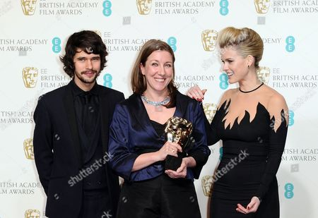 British actor Ben Whishaw, left, costume designer Jacqueline Durran, accepting the award for Make Up and Hair on behalf of Lisa Westcott, center, and actress Alice Eve pose backstage at the BAFTA Film Awards at the Royal Opera House, in London