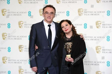 British director Danny Boyle, left, and producer Tessa Ross with the award for Outstanding British Contribution to Cinema backstage at the BAFTA Film Awards at the Royal Opera House, in London