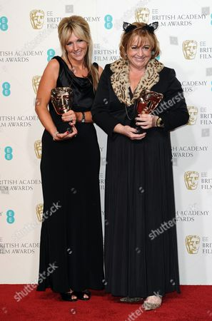 Anna Lynch-Robinson, left, and Eve Stewart pose with the Production Design award for backstage at the BAFTA Film Awards at the Royal Opera House, in London