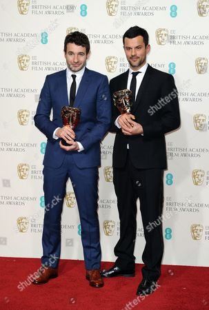 Director Bart Layton, left, and producer Dimitri Doganis pose with the award for Outstanding Debut by a British Writer, Director or Producer backstage at the BAFTA Film Awards at the Royal Opera House, in London
