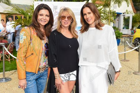 Sonia Nassery Cole, left, Ramona Singer, middle, and Cristina Greeven Cuomo attend Beach Magazine's Cover Party at Osteria Salina in Wainscott, in New York
