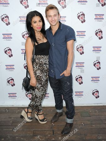 Stock Image of Chrissie Fit, left, and Kent Boyd arrive at BOBS from Skechers' summer soiree to celebrate over 5 million donated pairs of shoes to children in need at the Skybar on in Los Angeles