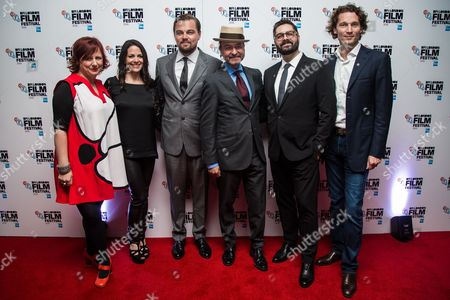 From left, Clare Stewart, Courteney Monroe, Leonardo DiCaprio, director Fisher Stevens, Tim Pastore and Jan Koeppen pose for photographers during a photo call to promote the film 'Before the Flood', showing as part of the London Film Festival in London
