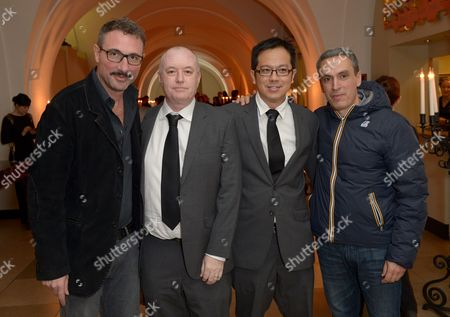 Directors Fabio Grassadonia (left), Anthony Chen (third from left) and Antonio Piazza (right) pose with guests at the 57th BFI London Film Festival Awards Night at Banqueting House Whitehall,, in London