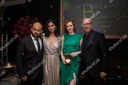 From left, Artists for Peace and Justice CEO David Belle, actress Moran Atias, model Karen Elson and film dirctor Paul Haggis, pose for photographers during the 'Brilliant is Beautiful' fund raiser dinner organized by the NGO Artists for Peace and Justice, in London