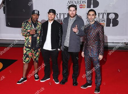 British electronic music quartet Rudimental, from right Amir Amor, DJ Locksmith, Kesi Dryden and Piers Aggett arrive at the BRIT Awards 2014 at the O2 Arena in London on