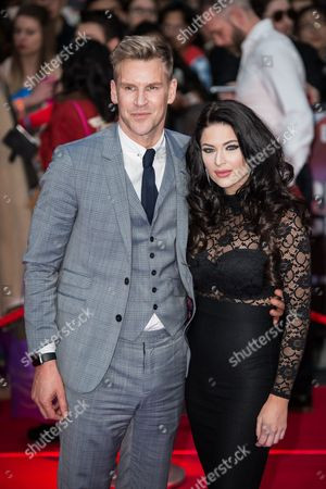 Craig Stevens and guest pose for photographers upon arrival at the premiere of the film 'Captain America Civil War' in London