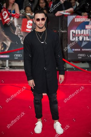Mason Noise poses for photographers upon arrival at the premiere of the film 'Captain America Civil War' in London